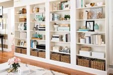 a large built-in bookshelf unit with lots of books, vases, baskets and candles is a cool idea for a home office