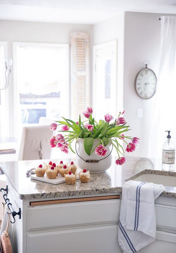 a large white porcelain jar with bright pink tulips is a bold spring centerpiece that looks fresh and romantic