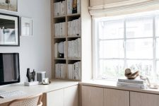 a light-colored plywood bookshelf unit with much closed storage spaces is a modern and fresh idea for a home office