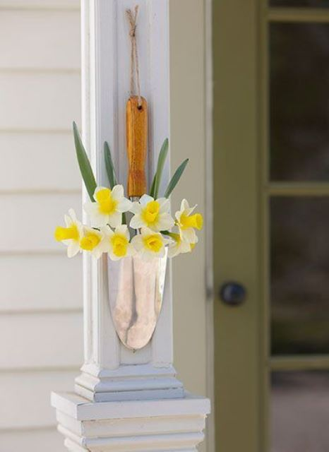 a lovely outdoor decoration of a shovel and daffodils will give a sweet rustic touch to your space