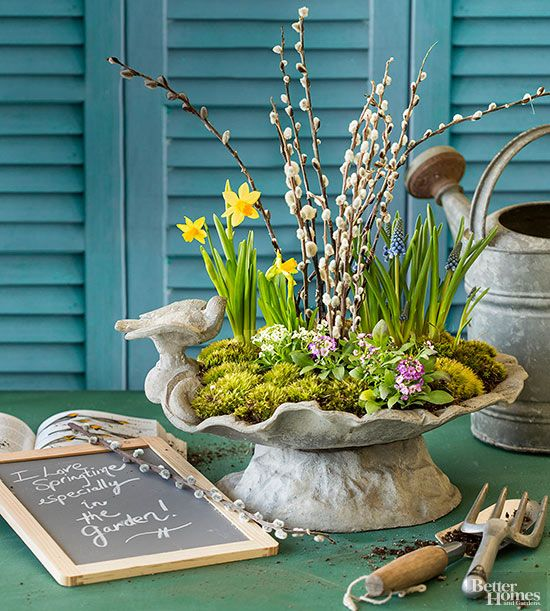 a lovely spring centerpiece of a vintage bowl with daffodils, hyacinths, willow, moss is amazing