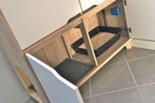 a minimalist cabinet with a cat litter box inside and more storage space aobve – it may be used for all the necessary things