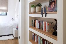 a passway with built-in bookshelves will save a lot of your space and keep all your books in order