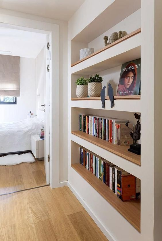 a passway with built in bookshelves will save a lot of your space and keep all your books in order