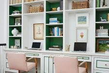 a refined home office with built-in bookshelves with green backing and pink metallic chairs and a faux zebra rug