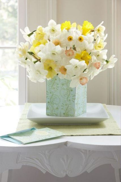 a refined spring centerpiece of a vase on a tray and lots of daffodils is a great idea for spring decor