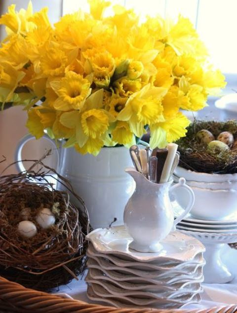 a rustic decoration of fake nests with eggs, a white jug with daffodils can be used as a spring centerpiece