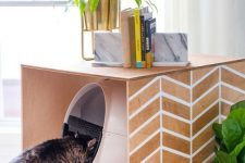 a stenciled cat litter box cover can double as a simple side table or an additional cat bed