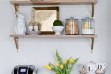 a striped bowl with lemons, a greenery wreath, yellow tulips in a white vase is cool spring kitchen decor