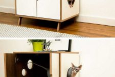 a stylish mid-century modern cabinet on legs, with an entrance, some windows and a bright cat litter box inside
