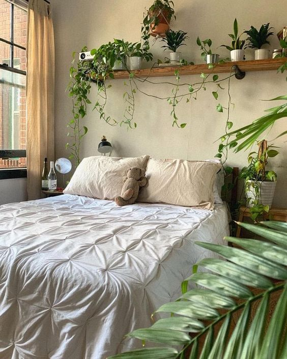a welcoming boho spring bedroom in neutrals, with potted greenery and some accessorie sis welcoming