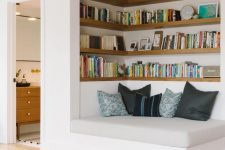 a welcoming nook with built-in shelves and a comfy daybed is a cool space to spend some time reading and relaxing