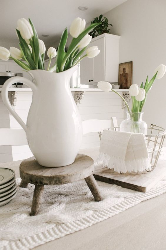 a white jug and a clear vase with some white tulips are nice spring decorations to rock, they will bring a casual feel to the space