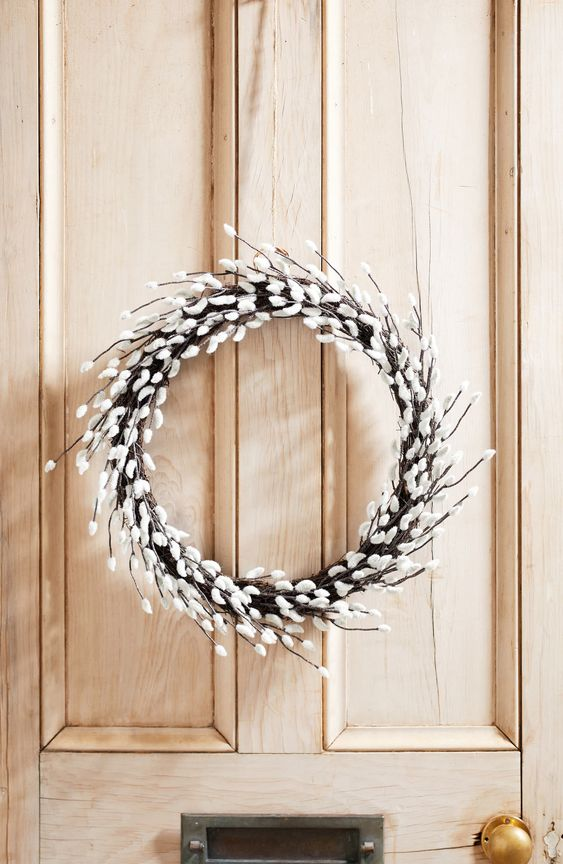 a willow wreath is an ideal front door decoration to mark your home for spring or Easter