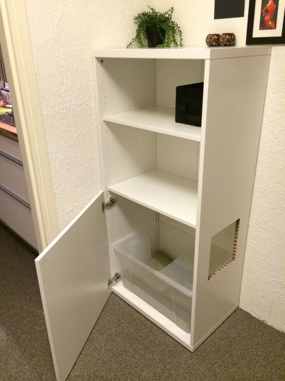 an IKEA hack - a Besta unit with a cat litter box inside and a comfortable entrance is cool and easy