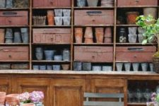 an oversized open shelving unit with some drawerrs inserted provides lot sof storage space and will be enough for your shed