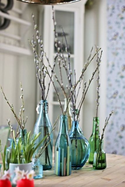 blue and green bottles and vases with willow make a natural and cool spring decoration or Easter centerpiece