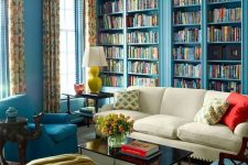 blue built-in bookshelves for designing a whole library in your living room