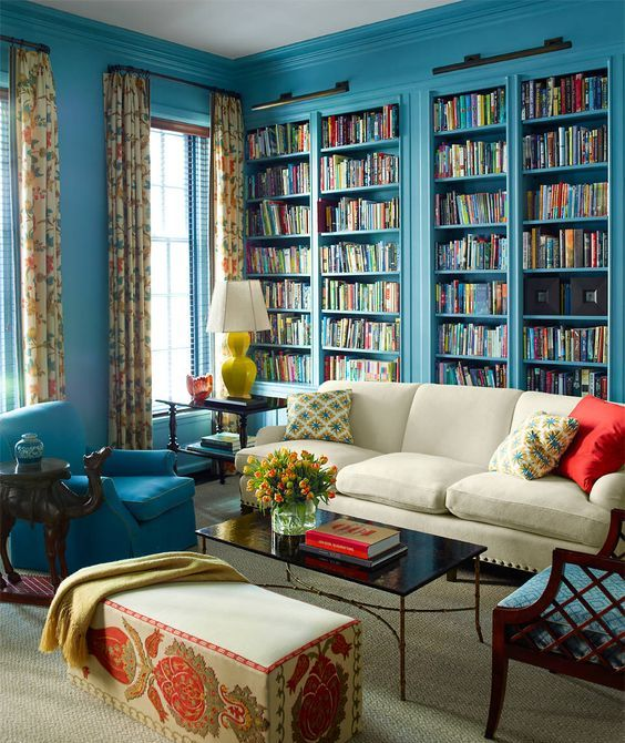blue built in bookshelves for designing a whole library in your living room