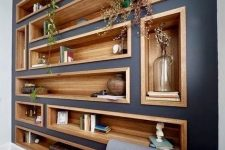bookshelves and niches built into a wall contrast it and make the use of this blank wall