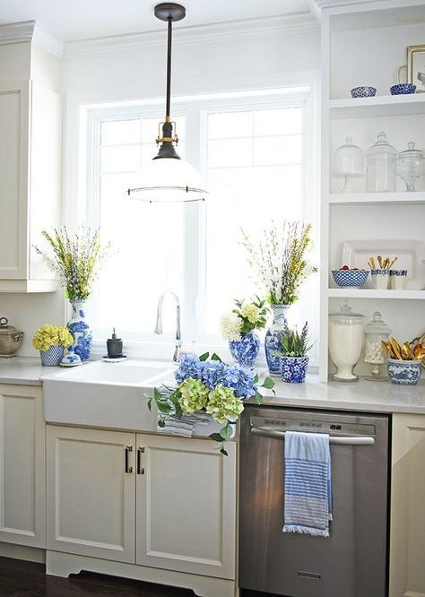 bright blue porcelain, blue and green hydrangeas, blooming branches for a spring farmhouse kitchen
