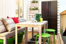 bright green planters for storage, matching stools, colorful barware and an umbrella for a spring or summer feel