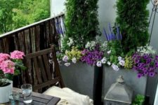 bright potted blooms and greenery and some simple garden furniture are amazing for a springy feel