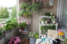 brigth flowers in pots, greenery and colorful cushions and pillows plus textiles for a spring feel
