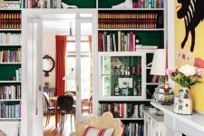 built-in bookshelves over the doorway are a nice way to decorate and use the wall and are amazing