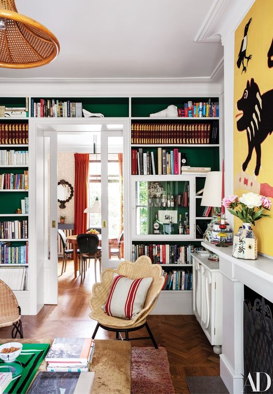 built in bookshelves over the doorway are a nice way to decorate and use the wall and are amazing