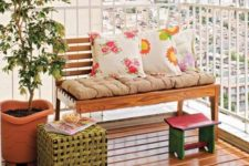 cheerful printed pillows and a pink footrest will immediately bring a fresh spring feel to the balcony