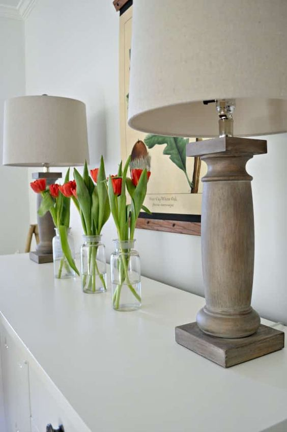 clear bottles with red tulips is a simple and modern spring arrangement with bright touches of color