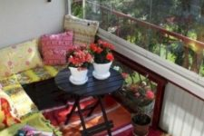 colorful printed textiles and blooms in pots will instantly change the look of the balcony
