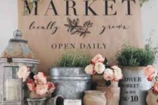 fresh blooms in pots, greenery in buckets and an artwork will give a vintage farmhouse spring feel to your space