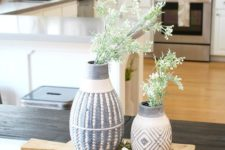 fresh greenery in printed vases on a wooden board will give a slight spring feel to your kitchen