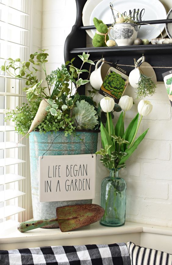 greenery in a bottle, a bucket with greenery and veggies and a moss bunny for a spring or Easter look