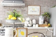 lemons in a bowl, a stand with lemons, greenery and an artwork make the kitchen feel farmhouse spring-like
