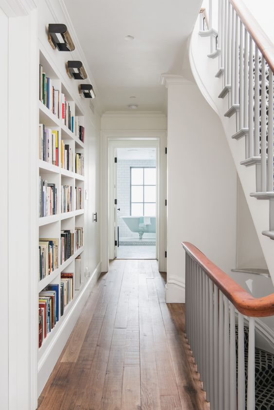 make osme built-in bookshelves in your passway or corridor to use this wall and save a lot of space