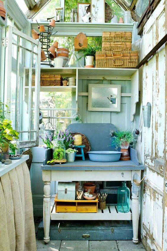 open shelves and tables with storage shelves are efficient and enough for a small garden shed