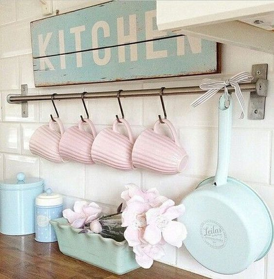 pink mugs, blue tableware and a blue sign will make your space pastel, sweet and spring-infused