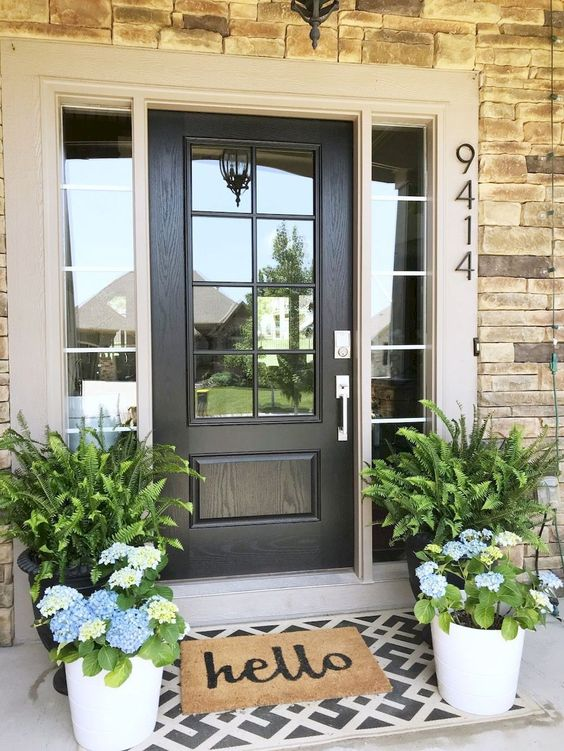 potted ferns and bright blue hydrangeas in pots will refresh your front porch for spring