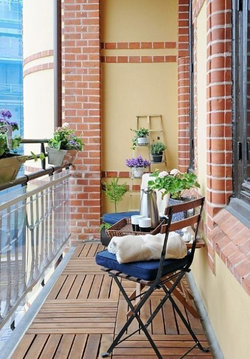 potted greenery and blooms and some usual garden chairs with cushions are nice for a spring outdoor space