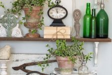 potted greenery, green bottles, green crosses for a slight spring touch in the space