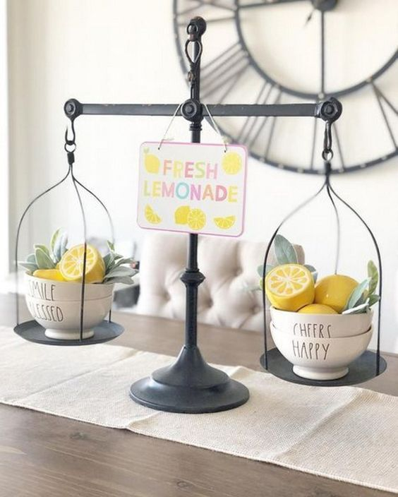 scales with faux lemons and greenery in bowls and a colorful sign will remind you of spring and summer