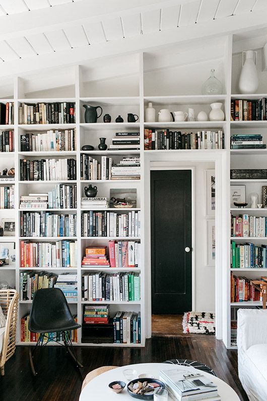 use the wall with your doorway to build in some bookshelves and to make the use of it