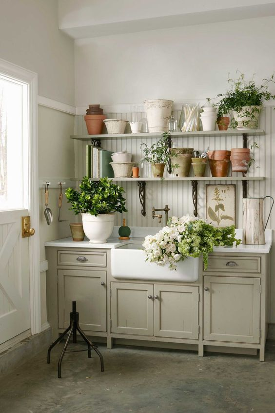 vintage kitchen cabinets used ina  garden shed for storage and for garden works, plus open shelves