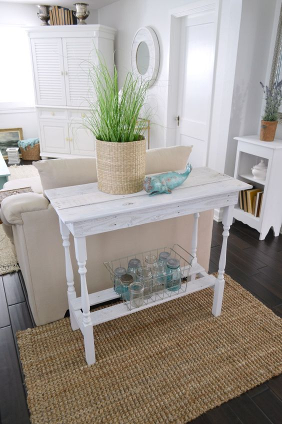 a delicate vintage whitewashed console table will match a vintage farmhouse or shabby chic space and will make the space more refined