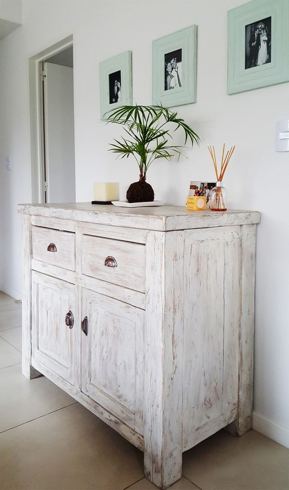 a delicate whitewashed credenza is a lovely idea not only for a vintage or farmhouse space but also for many others, too