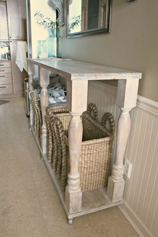 a long and large white console table on casters with baskets for storage is a nice idea for a farmhouse or just vintage space