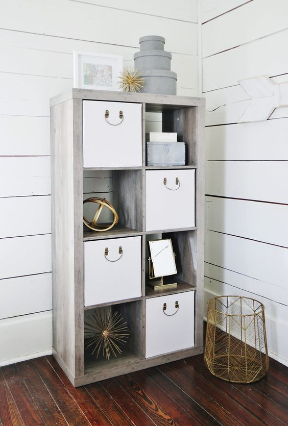 a modern whitewashed shelving unit with storage baskets and boxes is a cool idea for a modern farmhouse space